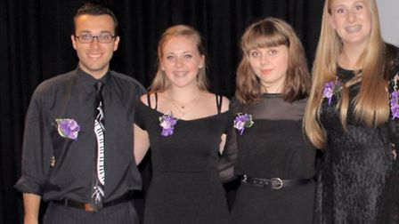 Conductor Jason Collins with some members of Cantaria.
