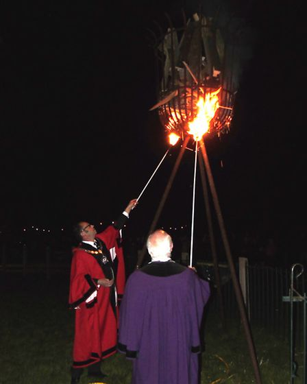 Bungay mayor Olly Barnes and town reeve Eamon Gaffney lighting the beacon.