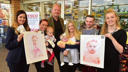 Natalie Clement, community champion at Tesco in Beccles, with Hayley Sharman and her daughter Ellie-