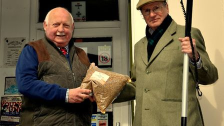 Gerald Burns (right) collecting his cargo of malt from Alex Carr, proprietor of the Halesworth Wine