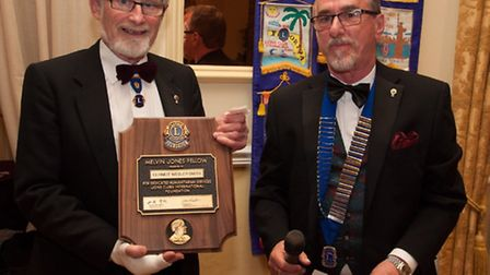 Dermot Wesley Smith recieves the MJF from Beccles Lions president Keith Moore. Picture: Submitted