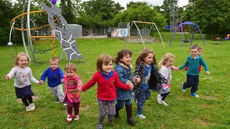 Youngsters from the Emanuel pre-school enjoying the new play equipment at the Honeypot play area in
