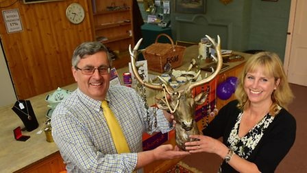 Mark Whistler and Anna Paulding from Durrants auction house with items that have been auctioned off