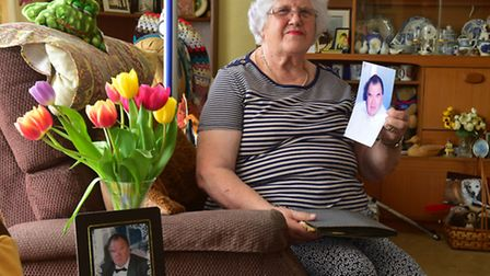 Betty Banham at home with photographs of her late husband Geoff. PHOTO: Nick Butcher