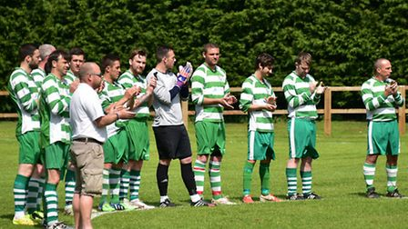 Gary Knights' memorial football match at Beccles Caxton FC. A minutes round of applause was held bef