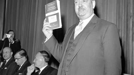 Dr Richard Beeching holding aloft a copy of the pamphlet 'The Reshaping of British Railways'. PIC: P