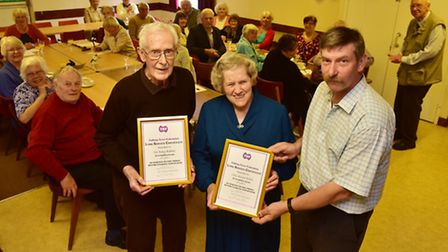 Vaughan Shea presents awards to Ray Baker and Anne Frith at The Three Rivers talking newspaper's cel