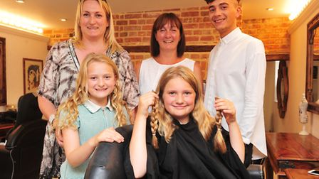 Izzy Goff (11) has her hair cut for the Little Princess trust.Izzy with her sister Michaela, mum, Fi