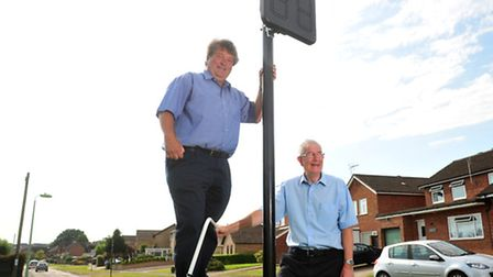 Councillor Chris Punt and mayor Graham Catchpole with one of the signs on Coney Hill. PHOTO: Nick Bu