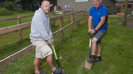 Buster Cooper and Mark Carter are getting ready to work on the new stand at Beccles Caxton Football