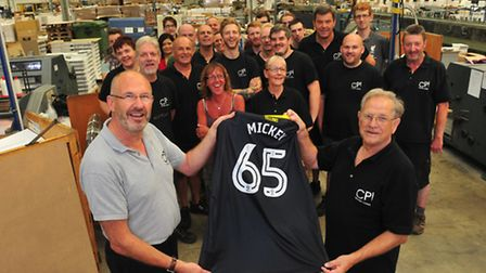 Production manager Richard Barratt presents Mickey Cook with a Norwich City shirt. PHOTO: Nick Butch