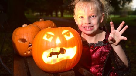 Yazmin Feek with her pumpkin getting ready for Beccles' first Pumpkin Festival. PHOTO: Nick Butcher
