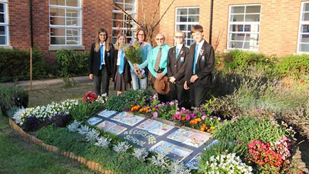 Beccles Free School pupils share their new garden with parents and (fourth from right) volunteer gar
