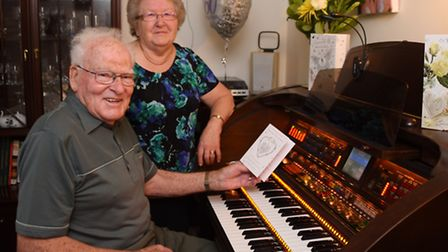 Diana and Douglas Carter sharing their hobby of playing the organ at their home at Worlingham as the