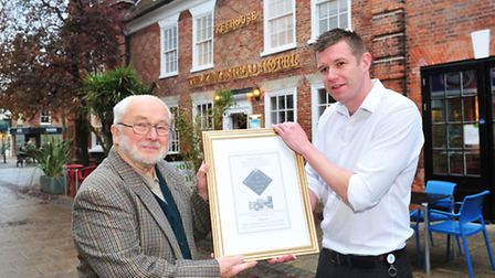 John Sayer from the Beccles Society presenting an award to the Lee Utting from the Kings Head Hotel