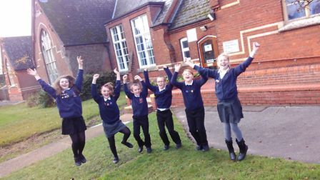 Bungay Primary pupils celebrating their recent Ofsted report.