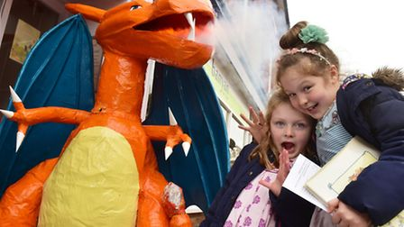Emily and Katie Proctor with the winning dragon scarecrow outside Edwards in Halesworth. PHOTO: Nick