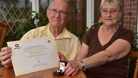 George and Judi Ackland-Snow with the Order of St John Award they received on Matthews behalf. PHOTO