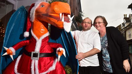 Kevin and Karen Prime with George the dragon in his Santa outfit outside Edwards Restaurant in Hales