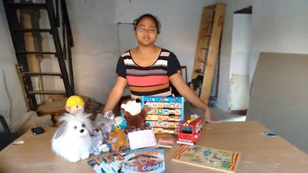 Daniela Ramasinoro receiving a donation of toys, including some sent over from Beccles.