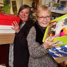 Sue Collins and Carole Hunt with some of the Christmas parcels that have been collected. PHOTO: Nick