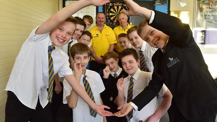 Pupils from Hobart High School who attend the lunchtime darts club, pictured with Norfolk players Vi