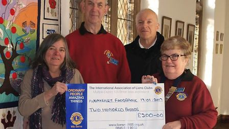 Bungay Lions Jane and Michael Gardiner presenting the cheque to Carole Hunt, distribution coordinato