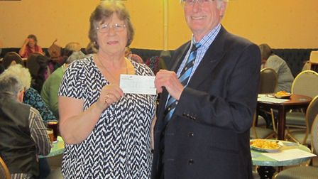 Brenda Clarke presenting a cheque for £1,000 to Dr Tony Bubb, chairman of the League of Friends at B