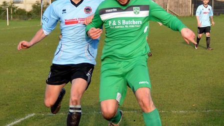 Luke Spears of Bungay Town, left, in action against Holt on Saturday. Picture by Shaun Cole.