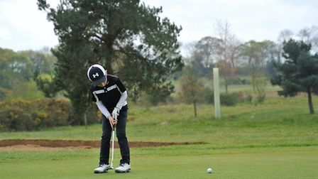 George Swallow playing golf