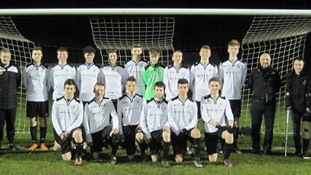 Beccles Town U18s line up for the camera alongside James Cushing from their sponsors, Broadwater Mou