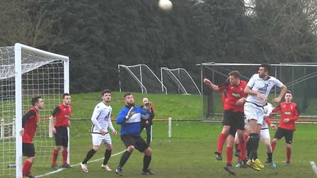 David Shade fires just over with strong header from a corner. Picture by David Walters.