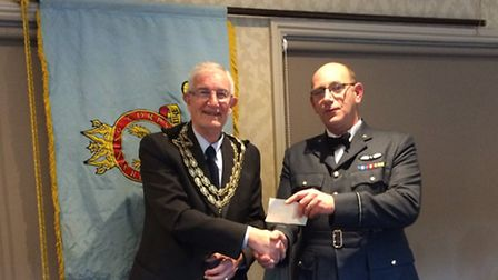 Beccles mayor Graham Catchpole presenting a cheque for £500 to Flying Officer Martin Dobson, Acting