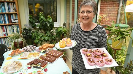 An open garden event at the home of Jane Bastow in St James South Elmham.Jan Chappell on the cake st