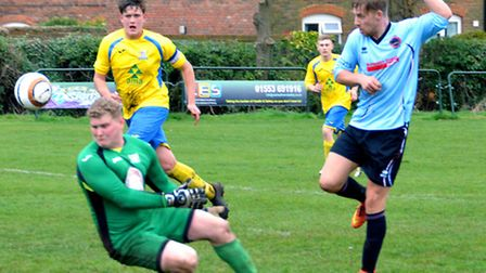 Dom Mirner scores his and Bungay's second goal at Dersingham on Saturday. Picture: Shaun Cole.