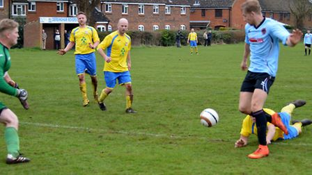 Dominic Mirner scores the first of his hat-trick which helped give Bungay Town a vital three points