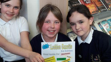 Annabel, Megan and Rosie with their newspaper