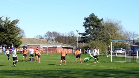 Liam Harvey-Cooper, on the far left, slides in goal number three for Beccles. Picture: David Walters