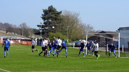 Lee Glover (2) rises to head in the opening goal for Beccles in their win over Hindringham last week