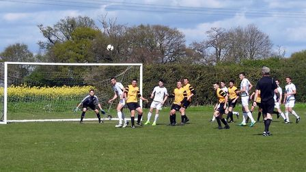 Beccles in action during their 2-1 win at Scole which guaranteed promotion. Picture: David Walters