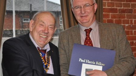 Nick Rudge on the right receives his award from club president Neil Peek. Credit: Beccles Rotary Clu