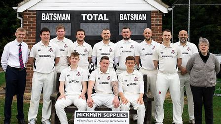 Beccles Town Cricket Club's first team line up for a photograph with Neil Hickman from sponsors Hi