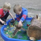 Sunbeams educare outdoor classroom day. The children using their imagination with the Fairy house an
