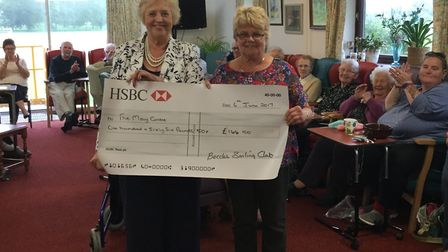 President of Beccles Amateur Sailing Club Janet Forster-Warnes presenting a cheque for £166.50 to Ma