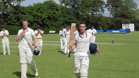 Topcroft's Harry Windridge is applauded off the pitch after his 107 not out against Beccles on Satur