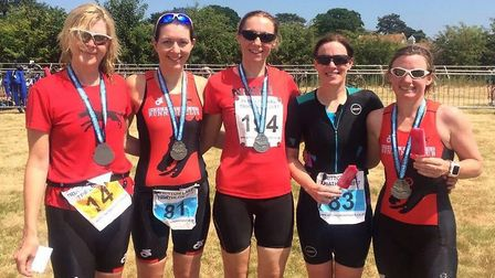 Bungay Black Dog athletes pose for a picture at the Fritton triathlon events (left to right): Jackie