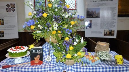 The Delia Smith Cook Book display at the Books in Bloom flower festival in Bungay. Picture: Bungay F