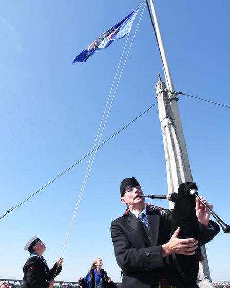 A flag is raised at the top of St Michales Tower to signal the start of the Beccles Charter Weekend.