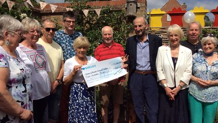 Members of Bungay Theatre Group handing over the cheque to trustees of Bungay Community Library frie