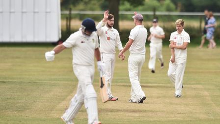 Bradfield celebrate claiming a Norwich A wicket during Saturday's Norfolk Alliance Division One matc
